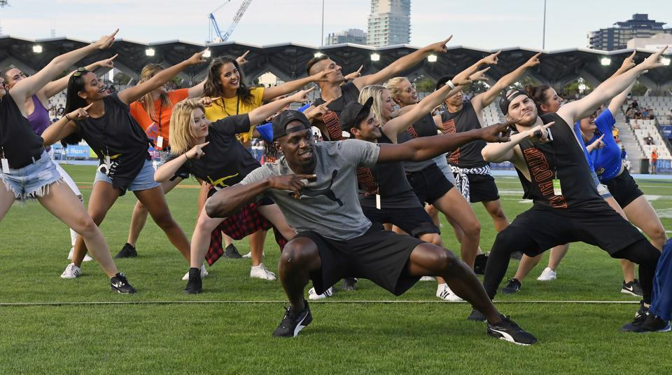 Usain Bolt entertains the crowd before the start of the Nitro Athletics meet in Melbourne on Saturday.