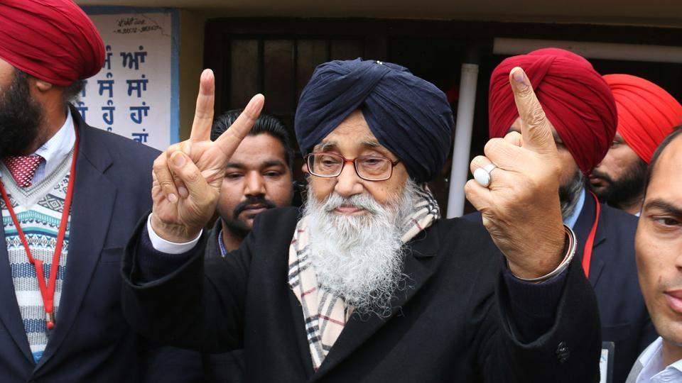 Punjab chief minister Parkash Singh Badal showing victory signs after casting his vote in Badal village on Saturday. (Sanjeev Kumar/HT photo)