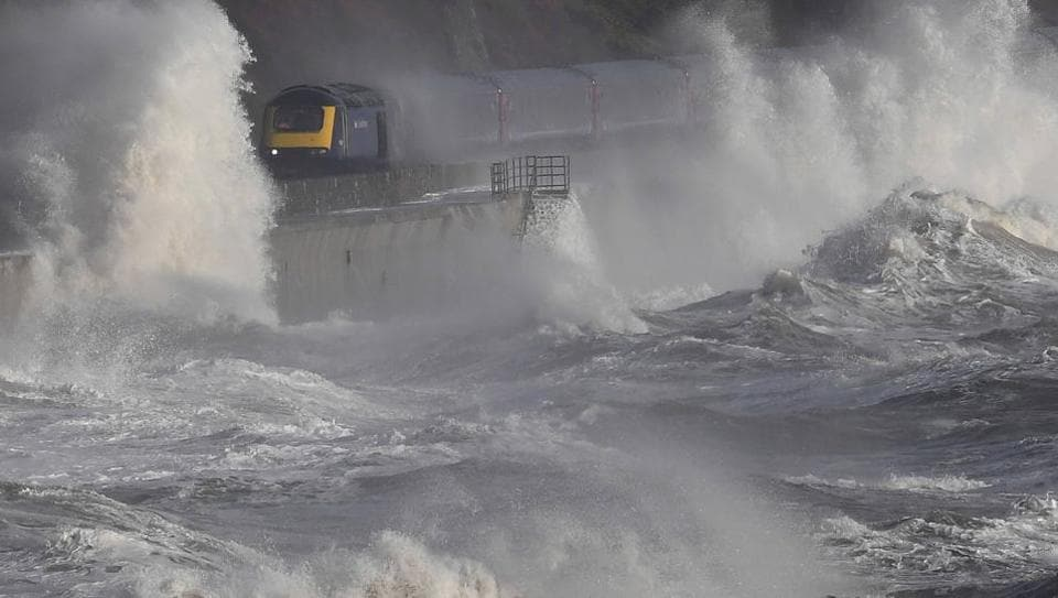 Waves hit a train during heavy seas and high winds in Dawlish in south west Britain, on February 2, 2017. (Toby Melville  / REUTERS)