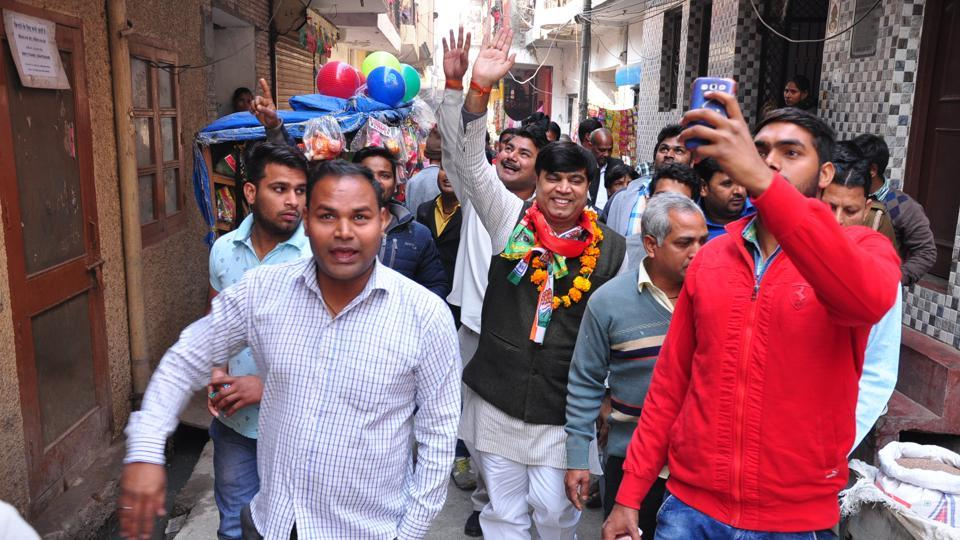 SP-Cong's Sunil Chaudhary (garlanded) campaigns with his supporters in Noida.