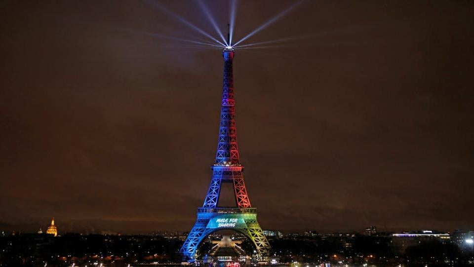 The Eiffel Tower is lit in the colours of the Olympic flag during the launch of the international campaign for the Paris bid to host the 2024 Olympic Games.   (Benoit Tessier  / REUTERS)
