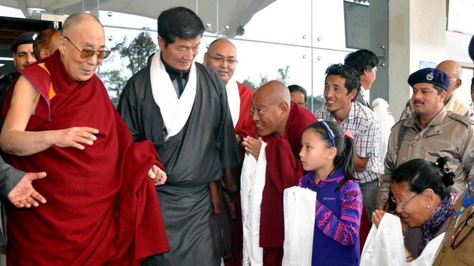 Tibetan spiritual leader, the Dalai Lama is greeted by devotees as he arrives at Gagal airport, near Dharamsala.