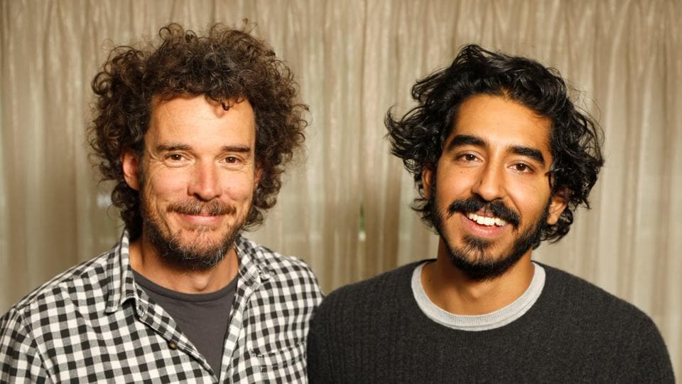 Director Garth Davis (L) and actor Dev Patel pose during press day for the film Lion in Los Angeles, California.