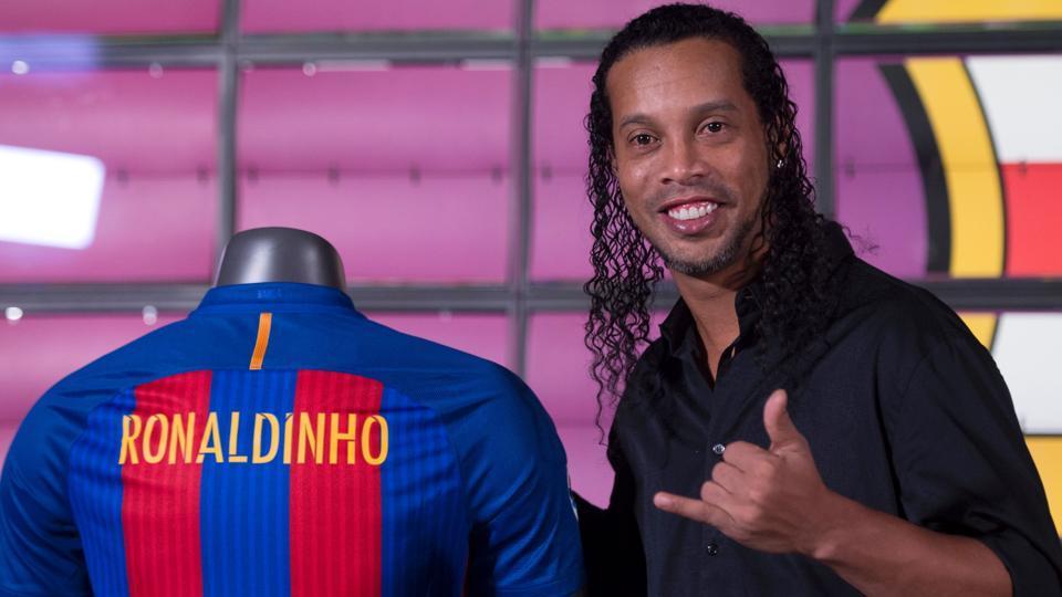 Ronaldinho poses during his official presentation as new FC Barcelona ambassador.
