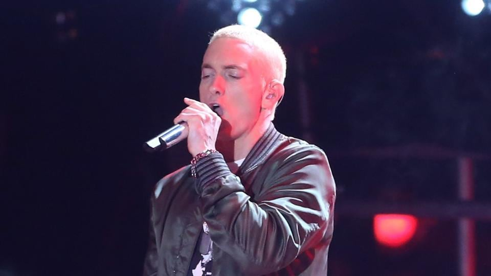 This file photo shows rapper Eminem (L) and singer Rihanna performing onstage at the 2014 MTV Movie Awards at Nokia Theatre L.A. Live in Los Angeles, California.