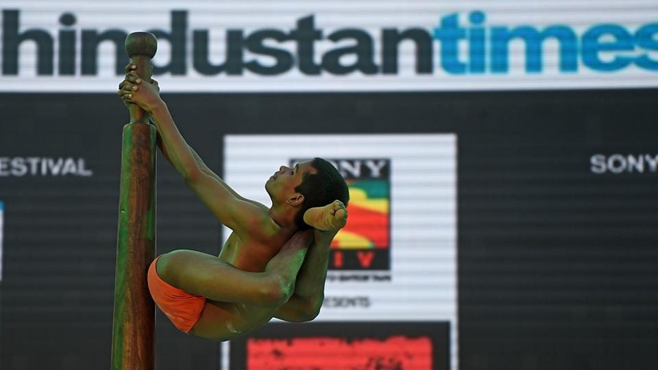 A school student performs Malkhamb at the festival. (Pratik Chorge/HT PHOTO)
