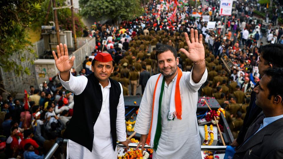 Congress party vice-president Rahul Gandhi and Uttar Pradesh state chief minister Akhilesh Yadav wave during a joint election rally with in Agra on Friday.