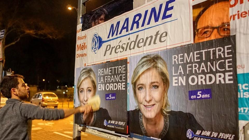 Members of the National Front youths put up posters of Marine Le Pen, French National Front (FN) political party leader and candidate for the French 2017 presidential election, ahead of a two-day FN political rally to launch the presidential campaign in Lyon, France.