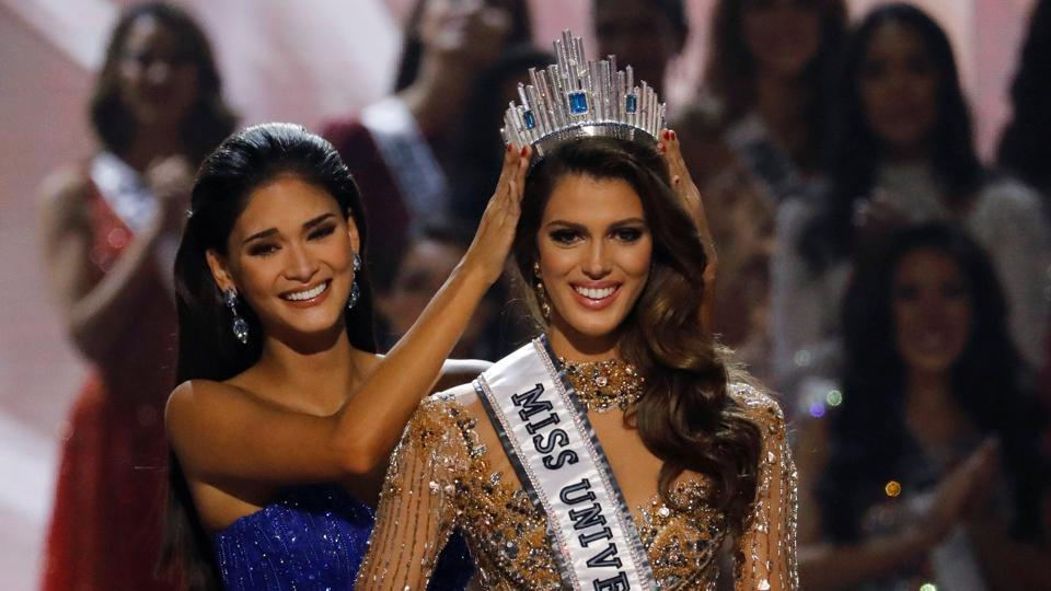 Pia Wurtzbach places the Miss Universe crown on Miss France, Iris Mittenaere, after the latter was declared the winner of this year's beauty pageant at the Mall of Asia Arena, in Pasay,  Philippines.   (Erik De Castro  / REUTERS)