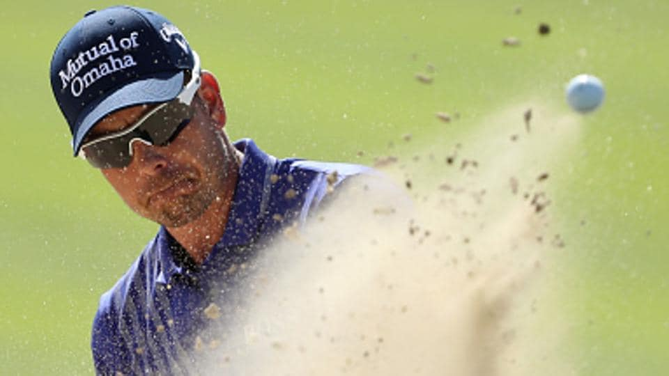 Henrik Stenson of Sweden hits his third shot on the 1st hole during the third round of the Omega Dubai Desert Classic.