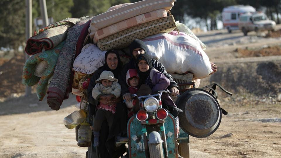 People who fled the violence from Islamic State-controlled northern Syrian town of al-Bab arrive in the rebel-held outskirts of the town, in Syria.   (Khalil Ashawi  / REUTERS)