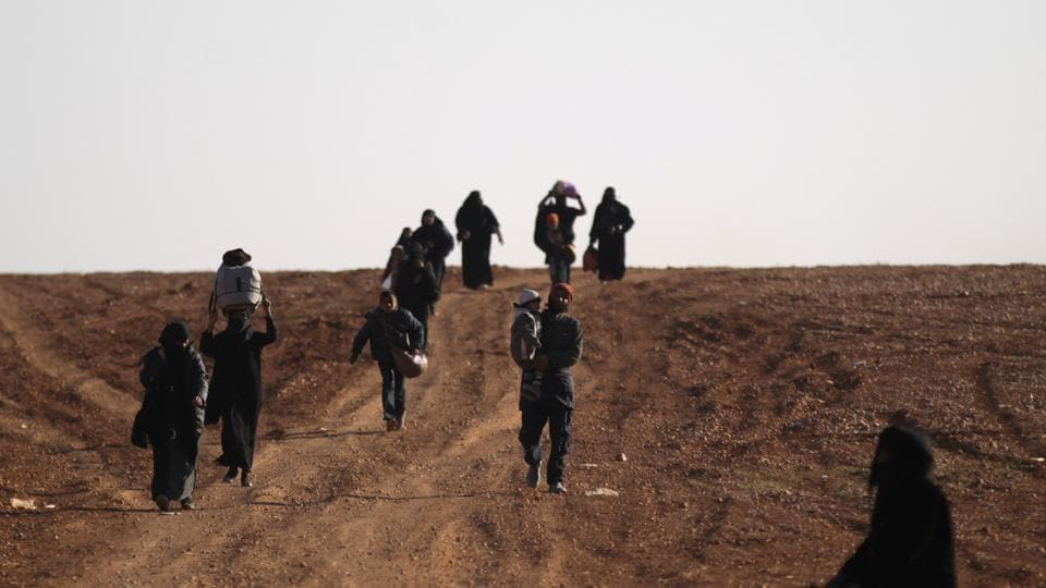 People who fled the violence from Islamic State-controlled northern Syrian town of al-Bab arrive in the rebel-held outskirts of the town, Syria.