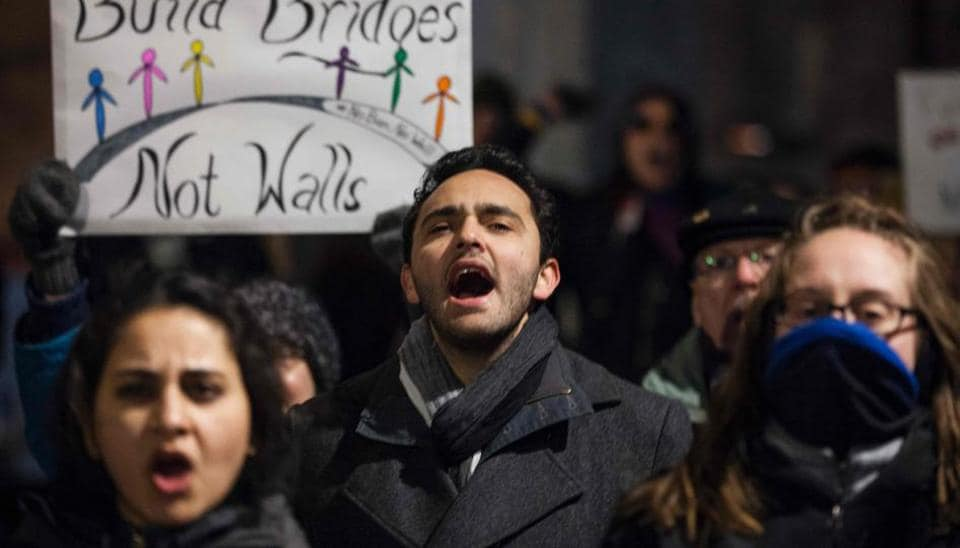 Demonstrators take part in a dance party outside Trump International Hotel organized by WERK for Peace to protest executive orders passed by US President Donald Trump in Washington, DC .