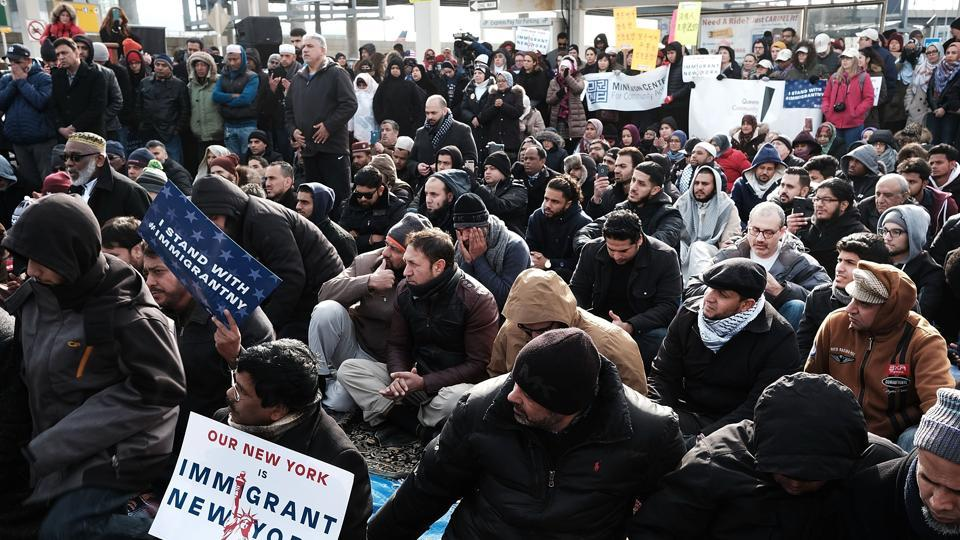 Protesters demonstrate against President Donald Trump's executive order banning immigrants and refugees from seven Muslim-majority countries at JFK airport in New York City.