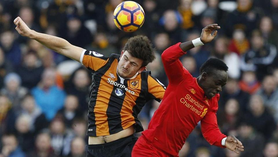 Hull City AFC's Harry Maguire in action with Liverpool FC's Sadio Mane during their Premier League match.
