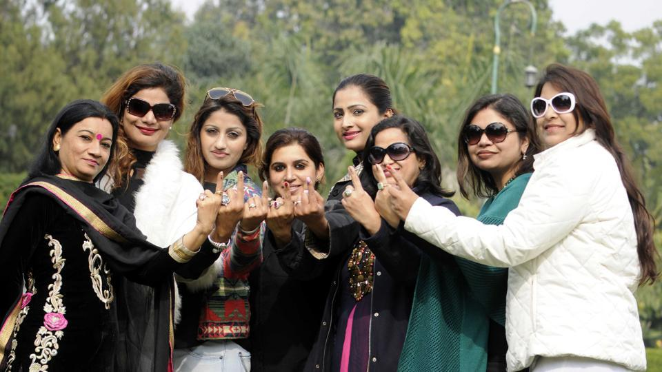 Female voters after casting their vote in Patiala on Saturday.