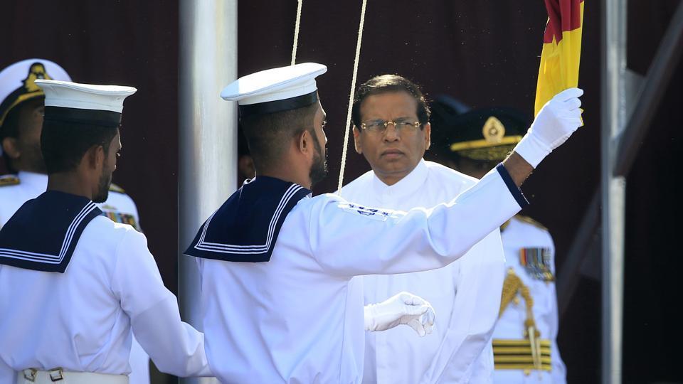 Sri Lankan president Maithripala Sirisena hoists the national flag during the Independence Day parade in Colombo, Sri Lanka, on February 4.