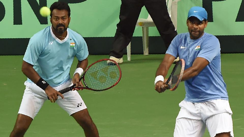 India's Leander Paes (L) and Vishnu Vardhan (R) compete in the Davis Cup doubles tennis match against New Zealand's Artem Sitak and Michael Venus.