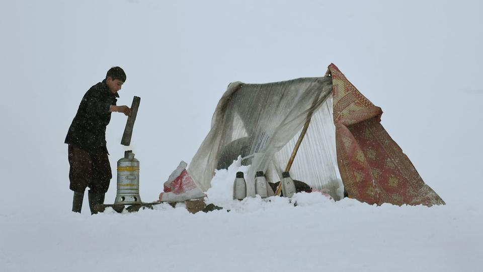 Afghan tea vendor Imran, 15, prepares tea for customers on a hillside during snowfall near Qargha Lake on the outskirts of Kabul on February 4, 2017. Avalanches after three days of heavy snow destroyed homes and killed over 20 people in central and northeastern provinces of the country.