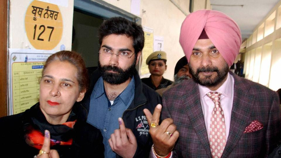 Congress candidate Navjot Singh Sidhu with his wife Navjot Kaur and his son after casting their votes at a polling station in Amritsar on February 4, 2017.