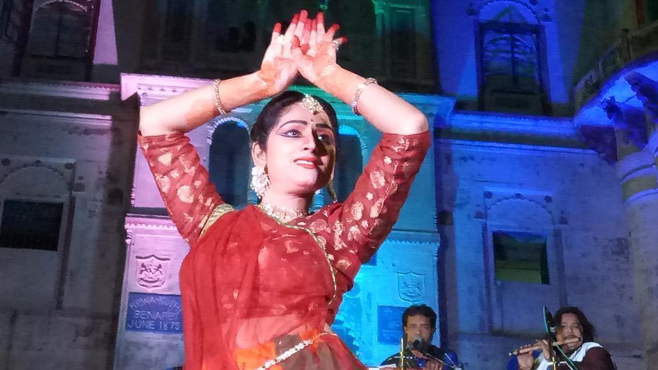 An artiste performing at Reeva Ghat during 'Ghat Sandhya' programme in Varanasi.
