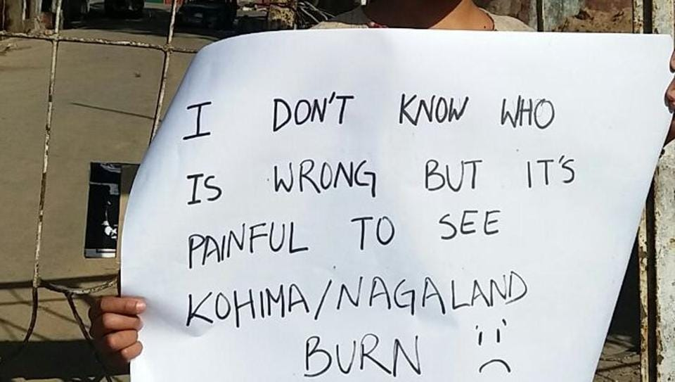 Rugotsono Iralu, a Kohima resident, expresses her feelings about the recent events outside the burnt Kohima Municipal building on Sunday.
