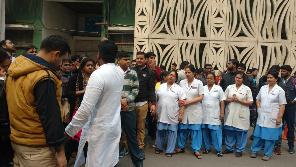 Nurses stage a protest at the AIIMS in Delhi on Sunday.