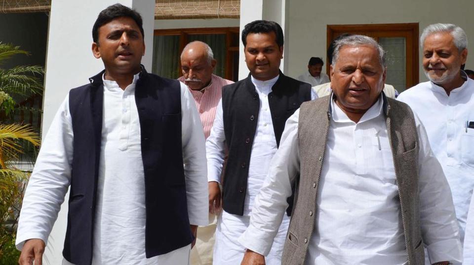 Samajwadi Party chief Mulayam Singh Yadav (right) and son Aklhilesh Yadav in Lucknow.