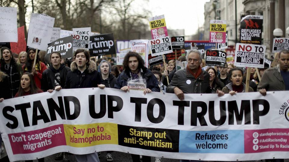 People take part in a protest march in London, against US President Donald Trump's ban on travellers and immigrants from seven predominantly Muslim countries entering the US.