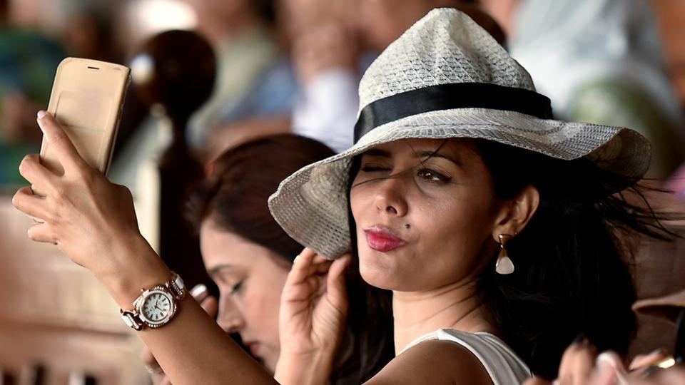 A girl takes a selfie during the derby in Mumbai. (Hindustan Times)