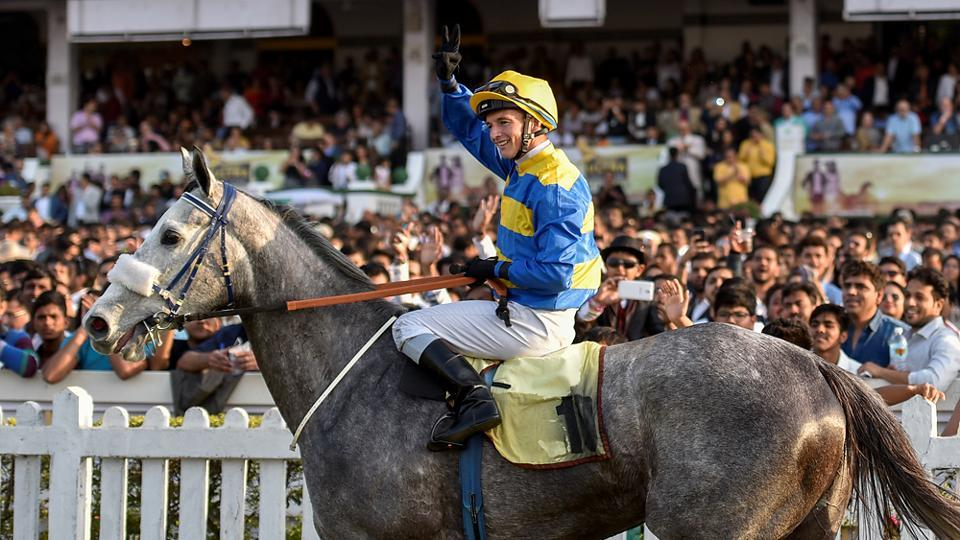 David Allen waves to the crowd after winning the derby. Grey filly Hall Of Famer won the race in 2 minutes, 31  seconds.  (Kunal Patil/Hindustan Times)
