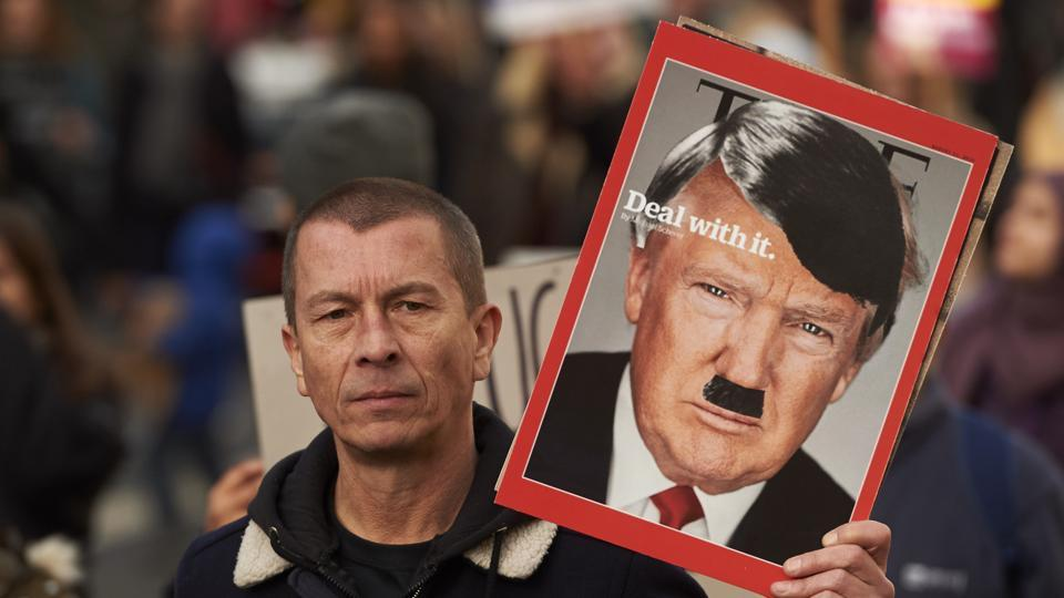 Demonstrators holding placards march in central London during a protest against US President Donald Trump on Saturday.