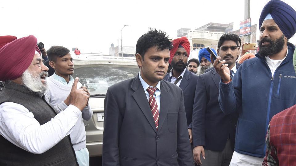 Akali minister Bikram Majithia and Congress leader Sukhjinder Raj Singh Lalli arguing outside a polling station in Majithia on Saturday.