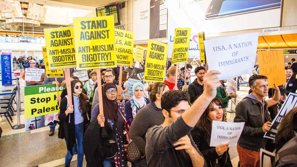 People protest against the executive order by US President Donald Trump, banning immigrants from seven majority-Muslim countries, at Los Angeles International Airport, California.