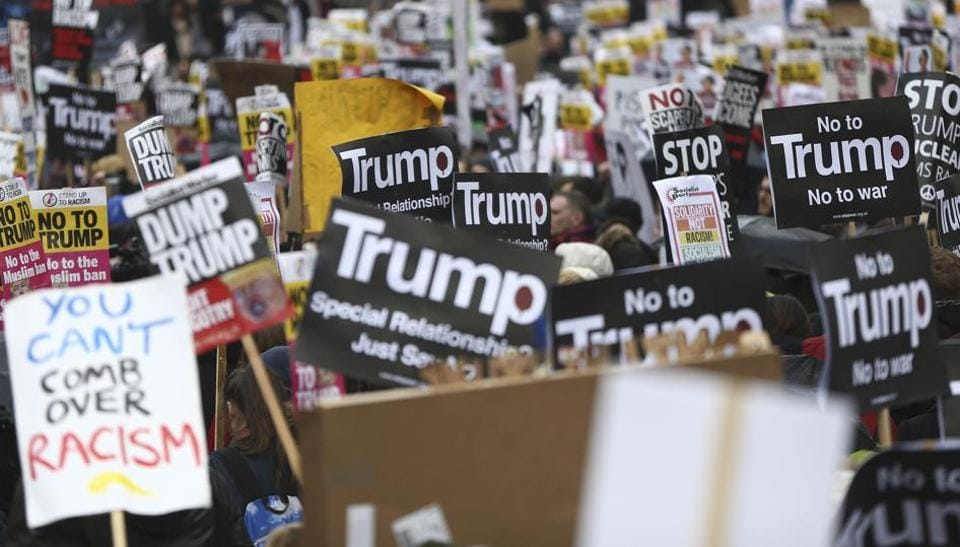 Demonstrators march against US President Donald Trump and his temporary ban on refugees and nationals from seven Muslim-majority countries from entering the United States, during a protest in London.