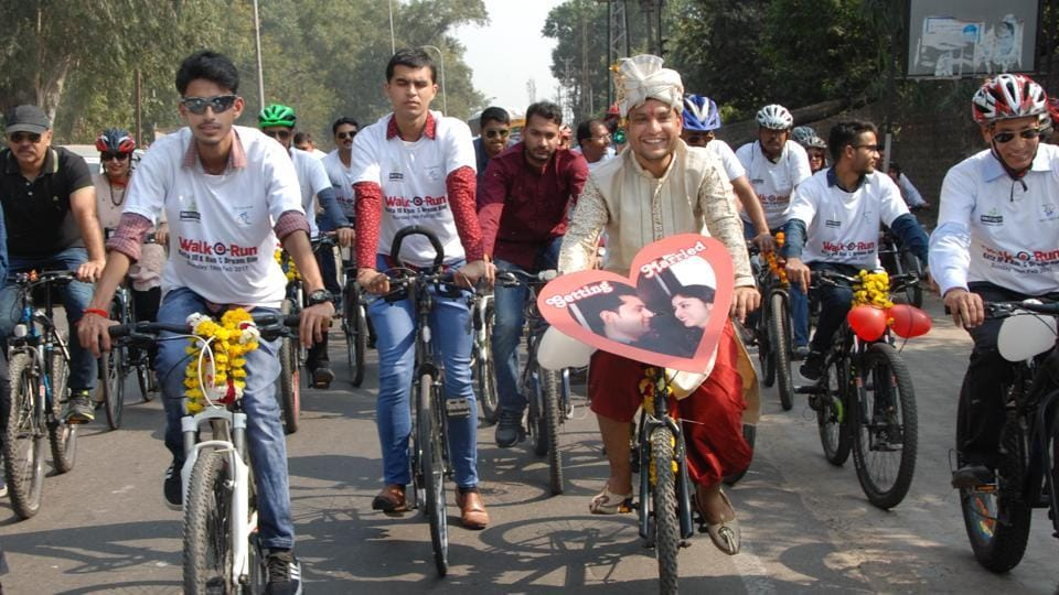 Groom Anant Triwedi during his wedding procession on bicycles in Kota to spread awareness about fitness and environment conservation.