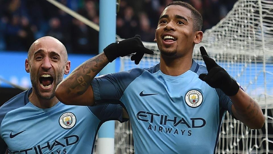 Manchester City's Gabriel Jesus (R) celebrates after scoring their late winning goal against Swansea.