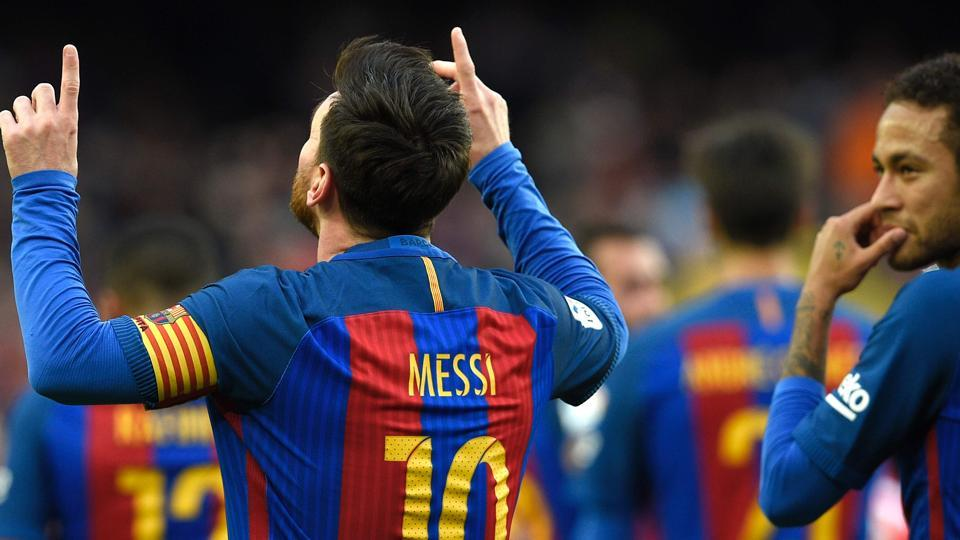 lionel messi helps f c barcelona close in on leaders real madrid