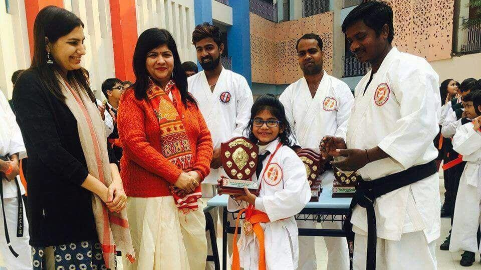 Ghazal Yadav receive a trophy from DPSWorld School principal on January 31, the day she died.