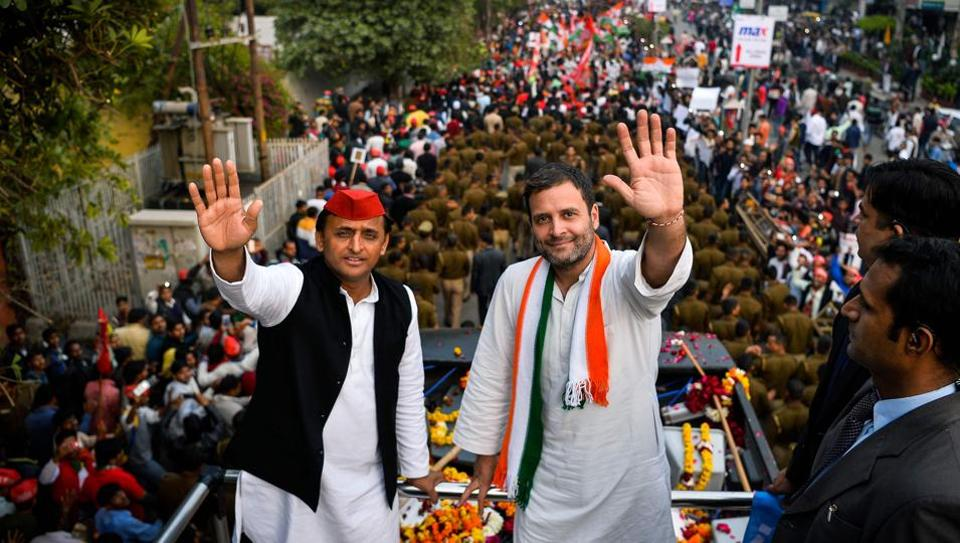 Congress party Vice President Rahul Gandhi (R) and Uttar Pradesh state Chief Minister Akhilesh Yadav (L) wave during a joint election rally with in Agra on February 3, 2017.