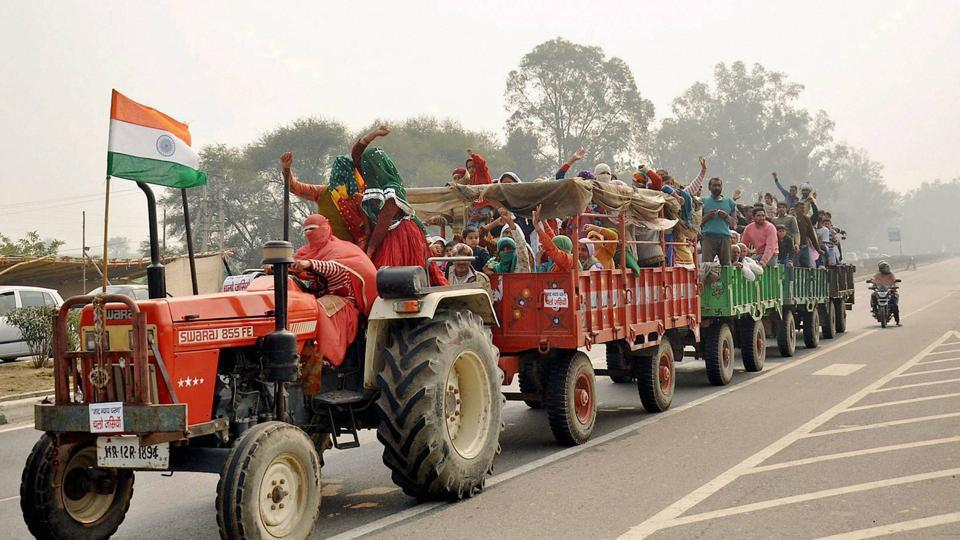Jat women protesters on tractor on their way to Jassia village to take part in the agitation for reservation at Jassia village in Rohtak on Sunday.