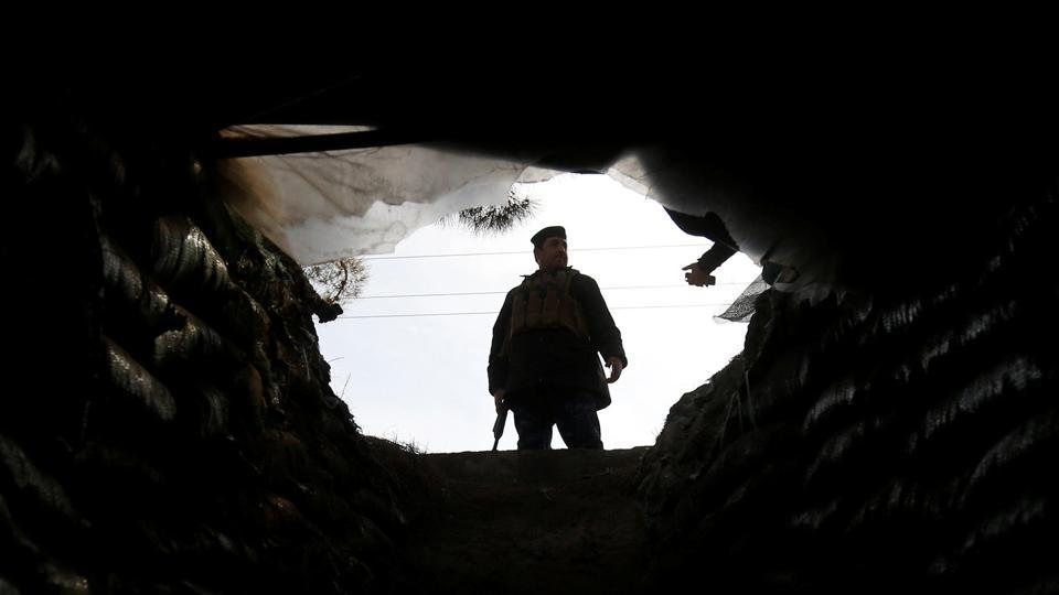An Iraqi federal police officer stands outside a tunnel, which was used by Islamic State militants, in Mosul, Iraq, on February 4, 2017.