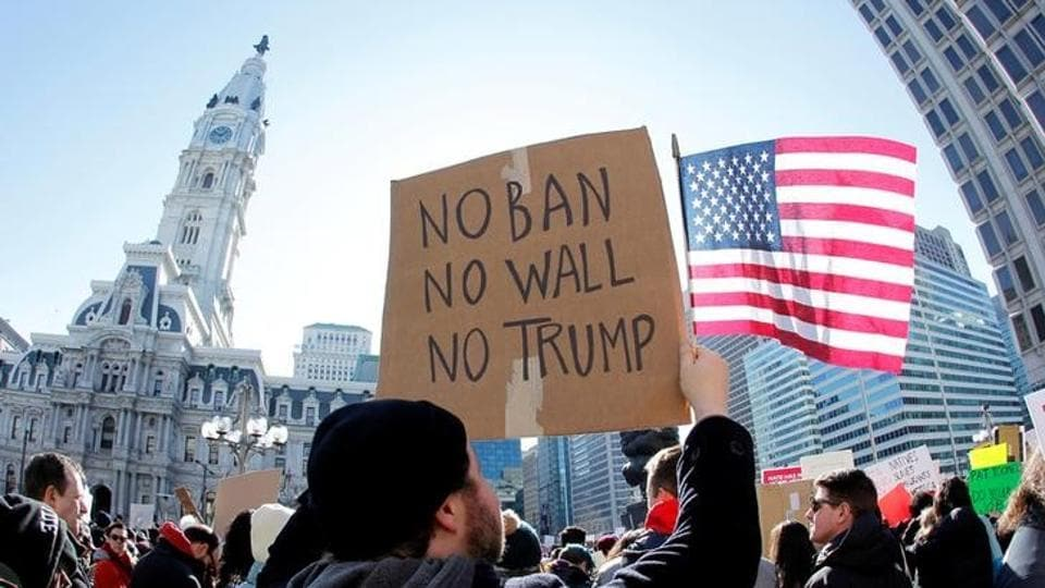 Protesters hold up a sign against US President Donald Trump's executive order banning refugees and immigrants from seven primarily Muslim countries from entering the United States during a rally in Philadelphia, Pennsylvania, US, on February 4, 2017.