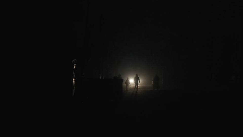 The silhouettes of Syrian men are seen as they walk in the rebel-held town of Douma. (Abd Doumany/AFP)