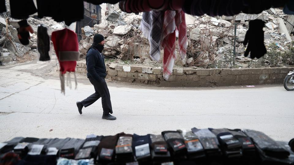 A Syrian man walks past a shop in Douma. (Abd Doumany/AFP)