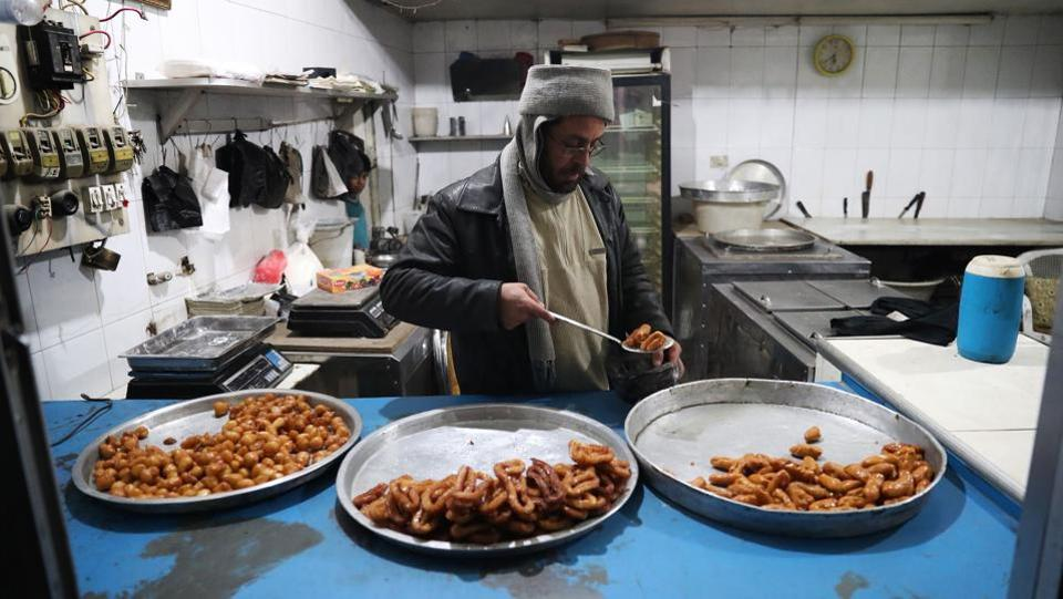 A Syrian man sells sweets in Douma. (Abd Doumany/AFP)