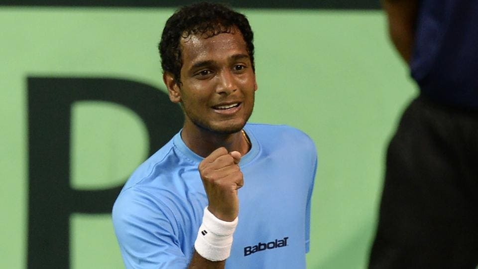 Ramkumar Ramanathan reacts after winning a point during the Davis Cup singles tennis match against New Zealand's Finn Tearney.