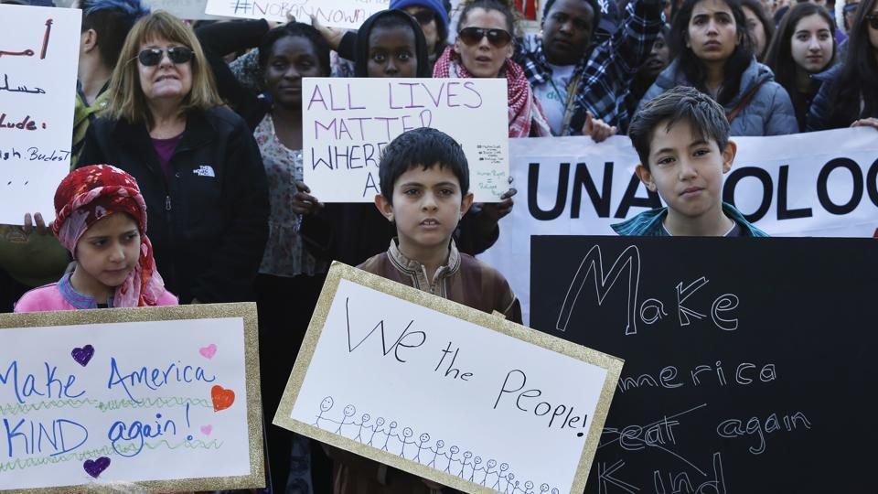 Thousands gather at Denver's City Center Park for a rally in support of the Muslim community and to protest President Donald Trump's executive order.