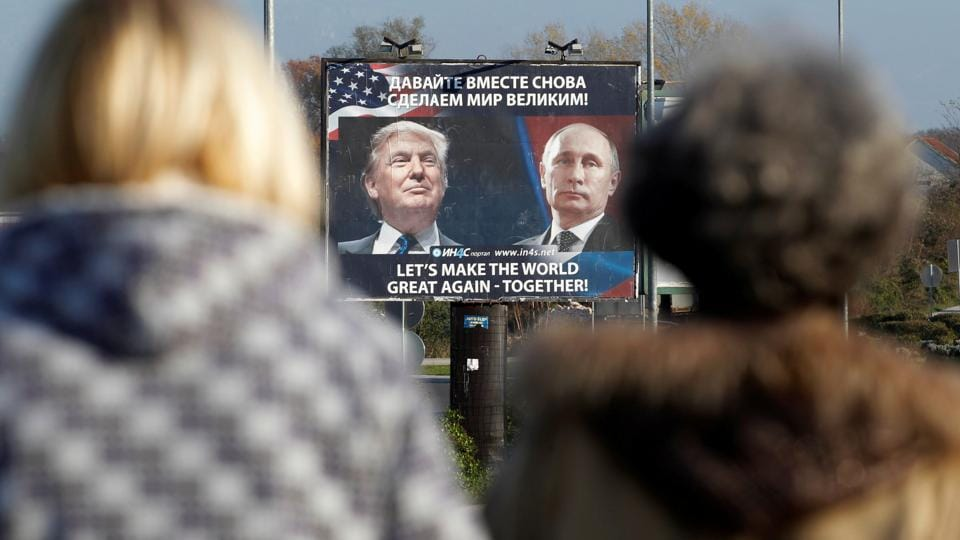 A billboard showing a pictures of US President Donald Trump and Russian President Vladimir Putin is seen through pedestrians in Danilovgrad, Montenegro, in November.