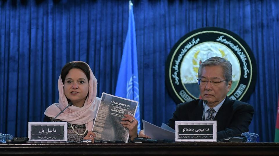 Danielle Bell (left), director of human rights of the UN Assistance Mission in Afghanistan (UNAMA), holds up a copy of a report of civilian casualties, as Tadamichi Yamamoto, the UN secretary-general's special representative for Afghanistan, looks on during a press conference in Kabul on Monday.